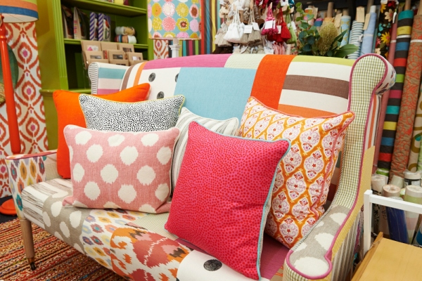 An eclectic mix of bright and bold cushions adds impact