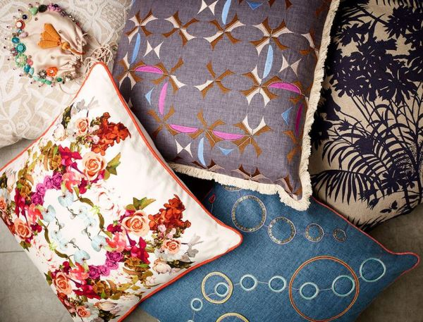 Left, No Chintz designer Natalie Atkinson's floral cushion with orange piping, $xxx, and all other cushions available from a range in-store at No Chintz.