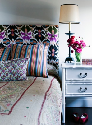 Chrissie mixed and Indian silk bedcover with an Ikat bedhead for an eclectic feel.